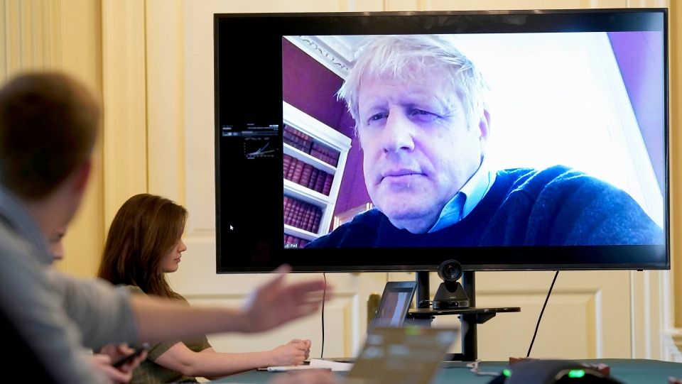In this Saturday, March 28, 2020 handout photo provided by Number 10 Downing Street, Britain's Prime Minister Boris Johnson chairs the morning Covid-19 Meeting remotely after self isolating after testing positive for the coronavirus, at 10 Downing Street, London. (Andrew Parsons/10 Downing Street via AP, File)