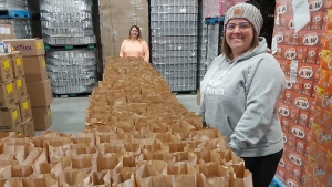"Bev Netusil, right, and Amanda Larkin help prepare bags of food for a breakfast program as they volunteer in Iqaluit, Nunavut, in this recent handout photo. A group of school staff in Iqaluit have banded together to ensure that schoolchildren in this northern capital don't go hungry because of closed schools. In a territory with some of the highest rates of food insecurity in the country, they're continuing to provide breakfasts to their students even if they're not running classes. ""Some kids really rely on it,"" said Jason Rochon, a Grade 3-4 student support worker at Joamie Ilinniarvik School. ""Every day, it's getting bigger and bigger."" THE CANADIAN PRESS/HO - Jason Rochon"