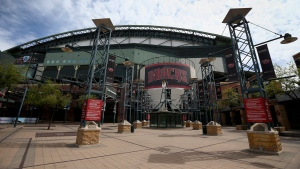 The main entrance in front of Chase Field is devoid of activity Thursday, March 26, 2020, in Phoenix. (AP Photo/Ross D. Franklin)