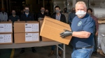 Ontario Premier Doug Ford loads ASTM Level 3 masks made by The Woodbridge Group in Woodbridge, Ont. on Tuesday, April 7, 2020. THE CANADIAN PRESS/Frank Gunn