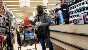 A customer wears a mask as she shops at a Jewel Osco grocery store in Mount Prospect, Ill., Saturday, April 4, 2020. (AP Photo/Nam Y. Huh)