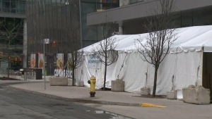 A COVID-19 assessment centre tent is seen outside Toronto's Women's College Hospital.