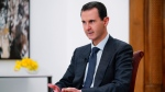 In this file photo released Monday Nov. 9, 2019 by the Syrian official news agency SANA, Syrian President Bashar Assad speaks in Damascus, Syria. (SANA FILE via AP)