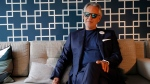 "FILE - This Nov. 13, 2019 file photo shows Italian tenor Andrea Bocelli during an interview in Paris. Bocelli will sing at the Duomo of Milan on Easter Sunday sending a message of love and hope to the world during the coronavirus pandemic, but the Italian tenor says it's not a concert. Instead, he calls it a ""prayer."" (AP Photo/Francois Mori, FIle)"