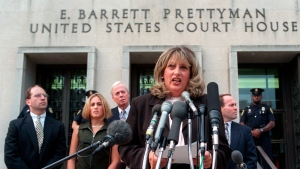FILE - In this July 29, 1998, file photo Linda Tripp meets with reporters outside federal court in Washington after her final appearance before a grand jury investigating an alleged affair between President Bill Clinton and Monica Lewinsky. Tripp, whose secretly recorded conversations with White House intern Lewinsky led to the 1998 impeachment of Clinton, died Wednesday, April 8, 2020, at age 70 .(AP Photo/Khue Bui, File)