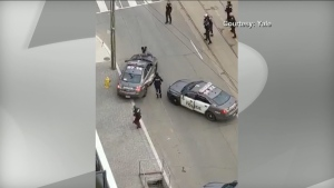 A viewer video shows a suspect being chased by Toronto police downtown on Sunday, April 12, 2020.