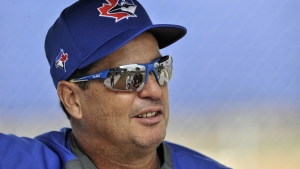 Toronto Blue Jays manager Charlie Montoyo waits for the start of a bullpen session during workouts at the team's spring training facilities in Dunedin, Fla., Friday, Feb. 14, 2020. Blue Jays manager Charlie Montoyo weighed in Thursday on how the organization and players are communicating and sharing information online during the pandemic. THE CANADIAN PRESS/Steve Nesius