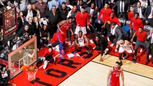 Kawhi Leonard (squatting, centre) of the Toronto Raptors watches his game-winning buzzer-beater shot go into the net, while playing against the Philadelphia 76ers in Game 7 of the Eastern Conference Semifinals of the 2019 NBA Playoffs, at the Scotiabank Arena, in Toronto, Canada, on 12 May 2019. THE CANADIAN PRESS/AP-Mark Blinch for NBAE