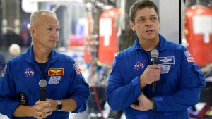 FILE - In this Thursday, Oct. 10, 2019 file photo, NASA astronauts Bob Behnken, right, and Doug Hurley talk to the media in front of the Crew Dragon spacecraft at SpaceX headquarters in Hawthorne, Calif. On Friday, April 17, 2020, NASA and SpaceX announced May 27 for resuming human launches from the U.S. after nearly a decade. Hurley and Behnken will blast off atop a SpaceX Falcon 9 rocket, departing from the same Kennedy Space Center launch pad used by Atlantis in July 2011. (AP Photo/Alex Gallardo)