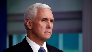 Then-U.S. Vice President Mike Pence listens as President Donald Trump speaks about the coronavirus in the James Brady Press Briefing Room of the White House, Friday, April 17, 2020, in Washington. (AP Photo/Alex Brandon)