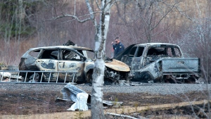 An RCMP investigator inspects vehicles destroyed by fire at the residence of Alanna Jenkins and Sean McLeod, both corrections officers, in Wentworth Centre, N.S. on Monday, April 20, 2020. A neighbour, Tom Bagley, was also killed on the property. Police say at least 19 people are dead, including RCMP Const. Heidi Stevenson, after a man, driving a restored police car, went on a murder spree in several Nova Scotia communities. Alleged killer Gabriel Wortman, 51, was shot and killed by police. THE CANADIAN PRESS/Andrew Vaughan