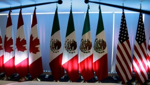 National flags representing Canada, Mexico, and the U.S. are lit by stage lights at the North American Free Trade Agreement, NAFTA, renegotiations, in Mexico City, Tuesday, Sept. 5, 2017. THE CANADIAN PRESS/HO, Marco Ugarte