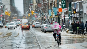 A Foodora courier picks up an order for delivery from a restaurant in Toronto, Thursday, Feb. 27, 2020. THE CANADIAN PRESS/Nathan Denette