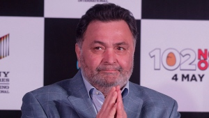 In this April 19, 2018 file photo, Bollywood actor Rishi Kapoor greets media as he arrives for the song launch of film '102 Not Out' in Mumbai, India. Rishi Kapoor, a top Indian actor and a scion of Bollywood's most famous Kapoor family, has died after a battle with cancer. He was 67.(AP Photo/Rafiq Maqbool, File)