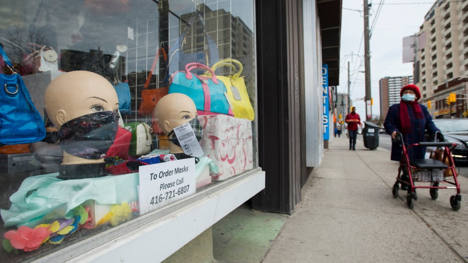 Mannequin heads are on display with face masks for sale in a storefront window during the COVID-19 pandemic in Toronto on April 29, 2020. (Nathan Denette / THE CANADIAN PRESS)