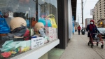 Mannequin heads are on display with face masks for sale in a storefront window during the COVID-19 pandemic in Toronto on Wednesday, April 29, 2020. THE CANADIAN PRESS/Nathan Denette