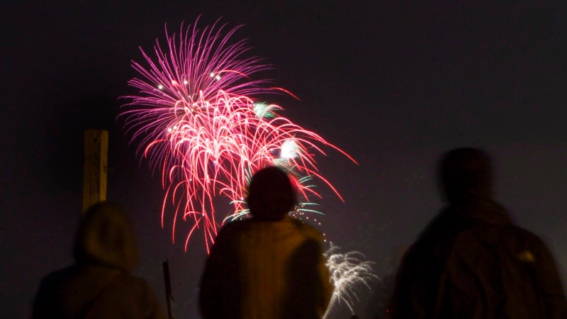 People watch the Toronto Victoria Day fireworks on the beach on Monday, May 20, 2013. THE CANADIAN PRESS/Chris Young