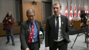 Dr. Tom Wong, Chief Medical Officer of Public Health at Indigenous Services Canada, left, and Minister of Indigenous Services Marc Miller leave a press conference on COVID-19 in West Block on Parliament Hill in Ottawa, on Thursday, March 19, 2020.THE CANADIAN PRESS/Justin Tang