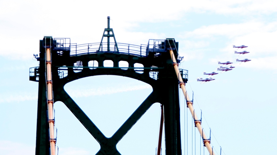 The Canadian Forces Snowbirds fly in the team's signature nine-jet formation, with trailing white smoke, over Fredericton, on Sunday,May 3, 2020. They flew over the city as part of Operation Inspiration which will see them fly over cities across the country starting in New Brunswick and Nova Scotia today and working west throughout the week. THE CANADIAN PRESS/Stephen MacGillivray