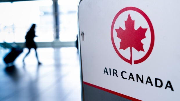 Air Canada will now require passengers to submit to a temperature check before boarding. (File photo)