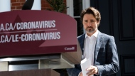 Prime Minister Justin Trudeau arrives for his daily news conference on the COVID-19 pandemic outside his residence at Rideau Cottage in Ottawa, on Sunday, May 3, 2020. THE CANADIAN PRESS/Justin Tang