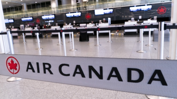 An empty Air Canada check-in counter is seen at Montreal-Trudeau International Airport in Montreal, on Wednesday, April 8, 2020. THE CANADIAN PRESS/Paul Chiasson