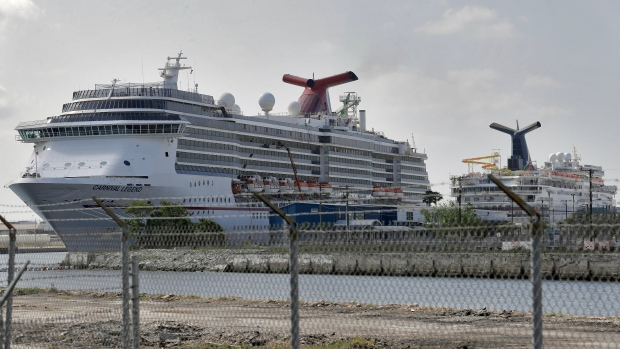 In a Thursday, March 26, 2020 file photo, Carnival Cruise ships are docked at the Port of Tampa in Tampa, Fla. Carnival Cruise Lines says it plans to gradually resume cruising in North America in August, nearly five months after it halted operations due to the new coronavirus. Sailings will begin on Aug. 1 with eight ships setting off from Galveston, Texas; Miami; and Port Canaveral, Florida. (AP Photo/Chris O'Meara, File)