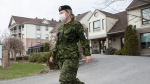 A member of the Canadian Armed Forces is shown at Residence Villa Val des Arbres a long-term care home in Laval, Que., Sunday, April 19, 2020, as COVID-19 cases rise in Canada and around the world. THE CANADIAN PRESS/Graham Hughes