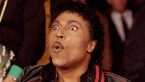"In this Nov. 13, 1986 file photo, Little Richard poses for the cameras as he is inducted into Rock Walk, a sidewalk collection of handprints and signatures of rock and roll musicians, in Los Angeles. Little Richard, the self-proclaimed ""architect of rock 'n' roll"" whose piercing wail, pounding piano and towering pompadour irrevocably altered popular music while introducing black R&B to white America, has died Saturday, May 9, 2020. (AP Photo/Mark Avery, File)"