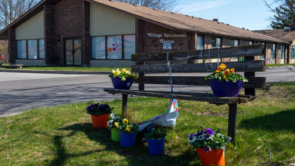 Flowers sit on a bench in front of Orchard Villa care home in Pickering, Ont. on Monday April 27, 2020. THE CANADIAN PRESS/Frank Gunn