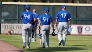 Members of the Toronto Blue Jays leave the field after a spring training baseball game against the Pittsburgh Pirates, Thursday, March 12, 2020, in Bradenton, Fla. THE CANADIAN PRESS/AP/Carlos Osorio