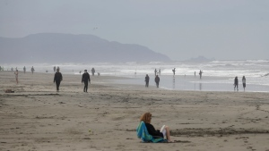 People visit Ocean Beach during the coronavirus outbreak in San Francisco, Sunday, May 10, 2020. (AP Photo/Jeff Chiu)