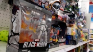 """An action figure based on the upcoming Marvel Studios film """"Black Widow"""" is displayed in the toy section at a Target department store, Thursday, April 30, 2020, in Glendale, Calif. Despite film delays, toy production and gaming companies are staying on schedule, releasing a variety of products tied to major titles in hopes of weathering through the pandemic. Most products are already in retail, appearing on store shelves and being sold online several months to a year ahead of the film's new release date. (AP Photo/Chris Pizzello)"""