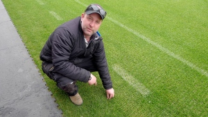 Robert Heggie, director of grounds for Toronto FC, points to the BMO Field grass which is having artificial fibres stitched in for a stronger hybrid playing surface in Toronto on Thursday, April 11, 2019. While Major League Soccer has been on hiatus since March 12 because of the global pandemic, Robert Heggie has been hard at it. The Toronto FC groundskeeper and a skeleton crew have been laying the groundwork for a perfect pitch for whenever the sport resumes. THE CANADIAN PRESS/Neil Davidson