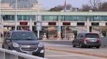 Vehicles cross the Rainbow Bridge. Wednesday, March 18, 2020, in Niagara Falls N.Y., (AP Photo/Jeffrey T. Barnes)