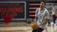 Toronto Raptors Malcolm Miller gets set to shoot during the Raptors training camp practice, Monday, September 30, 2019 at Laval University in Quebec City. Miller was the first Raptor to practise at the OVO Athletic Centre on Monday, when the team practice facility opened under strict guidelines. THE CANADIAN PRESS/Jacques Boissinot