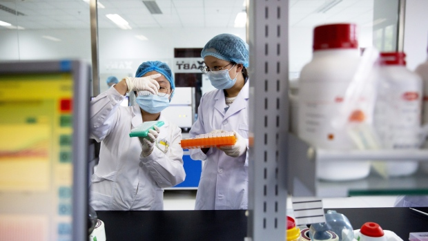 Health officials work in a laboratory. (The Canadian Press)