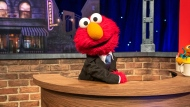 """This image released by Sesame Workshop shows muppet character Elmo, who will host a family friendly show called """"The Not Too Late Show with Elmo."""" It begins streaming May 27 on HBO Max. (Richard Termine/Sesame Workshop via AP)"""