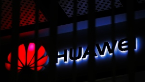 FILE - In this March 8, 2019, file photo, A logo of Huawei retail shop is seen through a handrail inside a commercial office building in Beijing. The U.S. government is imposing new restrictions on Chinese tech giant Huawei by limiting its ability to use American technology to build its semiconductors. The Commerce Department said Friday, May 15, 2020 the move aims to cut off Huawei's undermining of existing U.S. sanctions. (AP Photo/Andy Wong, File)