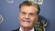 """FILE - In this April 26, 2015, file photo, Fred Willard poses in the pressroom at the 42nd annual Daytime Emmy Awards at Warner Bros. Studios in Burbank, Calif. Willard, the comedic actor whose improv style kept him relevant for more than 50 years in films like """"This Is Spinal Tap,"""" """"Best In Show"""" and """"Anchorman,"""" has died at age 86. Willard's daughter, Hope Mulbarger, said in a statement Saturday, May 16, 2020, that her father died peacefully Friday night. (Photo by Richard Shotwell/Invision/AP, File)"""