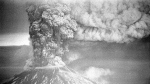 In this May 18, 1980, file photo, Mount St. Helens sends a plume of ash, smoke and debris skyward as it erupts. May 18, 2020, is the 40th anniversary of the eruption that killed more than 50 people and blasted more than 1,300 feet off the mountain's peak. (AP Photo/Jack Smith, File)