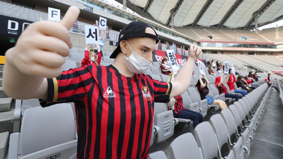 """In this May 17, 2020 photo, cheering mannequins are installed at the empty spectators' seats before the start of a soccer match between FC Seoul and Gwangju FC at the Seoul World Cup Stadium in Seoul, South Korea. A South Korean professional soccer club has apologized after being accused of putting sex dolls in empty stands during a match Sunday in Seoul. In a statement, FC Seoul expressed """"sincere remorse"""" over the controversy, but insisted that it used mannequins, not sex dolls, to mimic a home crowd during its 1-0 win over Gwangju FC at the Seoul World Cup stadium. (Ryu Young-suk/Yonhap via AP)"""
