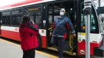 A TTC worker wears a mask in a bus while on shift in Toronto on Thursday, April 23, 2020. THE CANADIAN PRESS/Nathan Denette