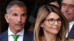 In this April 3, 2019, file photo, actress Lori Loughlin, front, and her husband, clothing designer Mossimo Giannulli, left, depart federal court in Boston after a hearing in a nationwide college admissions bribery scandal. (AP Photo/Steven Senne, File)