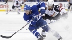 Toronto Maple Leafs defenceman Tyson Barrie (94) turns hard with the puck as Arizona Coyotes right wing Phil Kessel (81) defends during first period NHL hockey action in Toronto on Tuesday Feb. 11, 2020. THE CANADIAN PRESS/Nathan Denette
