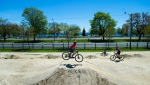 Cyclists ride the dirt jumps at the Sunnyside Bike Park during the COVID-19 pandemic in Toronto on Thursday, May 21, 2020. The Ontario government and the City of Toronto have announced the opening of some sports recreation facilities. THE CANADIAN PRESS/Nathan Denette