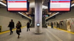 Subway riders walk past an interactive art installation at the new Pioneer Village station, in Toronto on Wednesday, January 3, 2018. THE CANADIAN PRESS/Christopher Katsarov