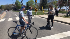 Mayor John Tory and Coun. Brad Bradford speak with some of the people taking advantage of the ActiveTO closure along Lake Shore Boulevard East on Saturday. (Twitter/@JohnTory)