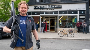 Pete Lilly of Sweet Pete's Bike Shop poses in front of his store in Toronto on Tuesday, May 19, 2020. THE CANADIAN PRESS/Frank Gunn
