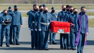 Pall bearers carry the casket of RCAF Capt. Jennifer Casey during a homecoming ceremony at Halifax Stanfield International Airport in Enfield, N.S. on Sunday, May 24, 2020. Casey, a military public affairs officer and a Halifax native, was killed in the crash of a Snowbirds Tutor jet in a residential area of Kamloops, B.C.. THE CANADIAN PRESS/Andrew Vaughan